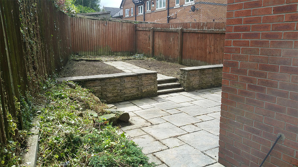 Weeds cleared from a concrete patio in Bolton