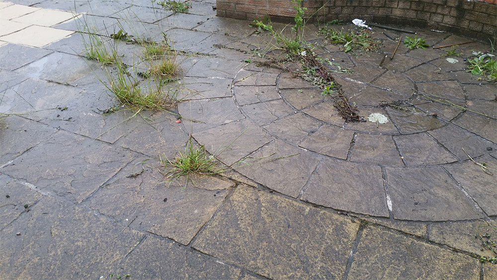 Dirty patio in Bolton needs jet washing