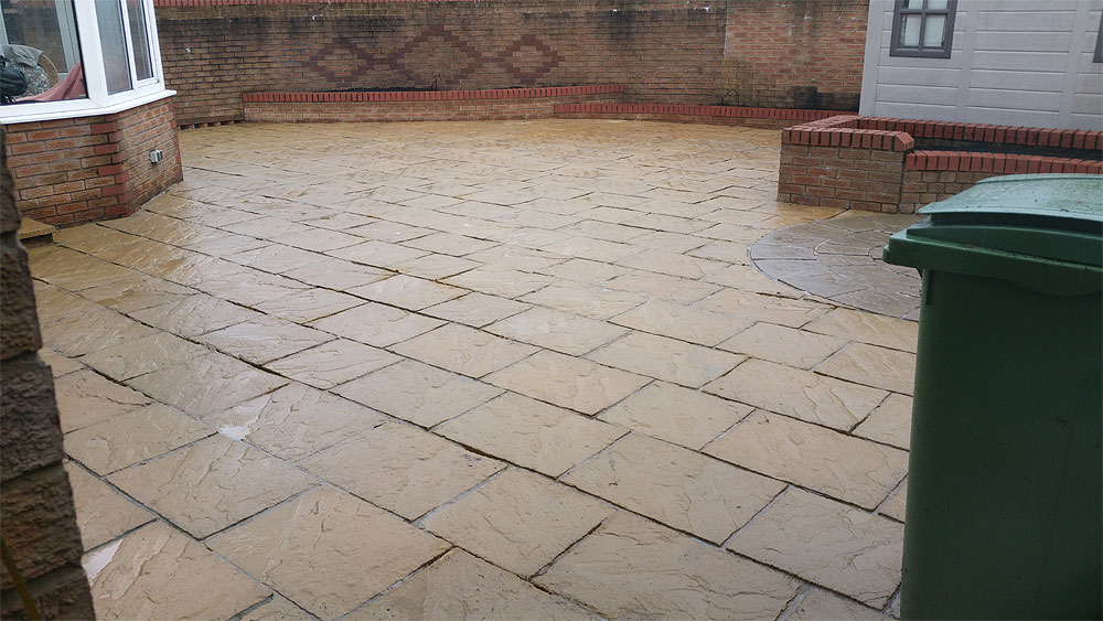 Concrete patio jet washed in Bolton