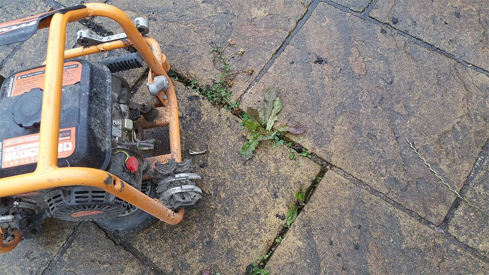 Our petrol jet washer takes care of the weeds in your patio Bolton